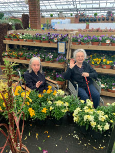 Two of our residents enjoy a day out choosing plants for the garden.