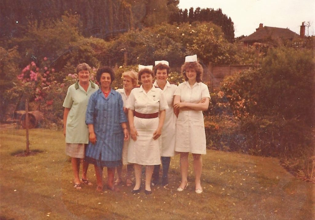Photos shows members of staff in uniform in house grounds. Early 80s.